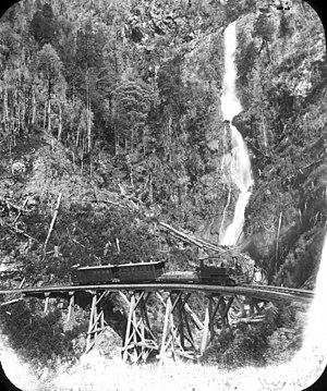 North East Dundas Tramway - G class 0-4-2T Sharp, Stewart & Co crosses the Montezuma Bridge on the North East Dundas Tramway with a mixed train to Zeehan around 1899