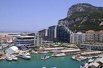 Ocean Village Marina, Gibraltar - Ocean Village Marina with Rock on right, runway and Marina Bay on far left