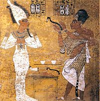 Pharaoh Ay (pictured to the right) performing the Opening of the Mouth ceramony on Tutankamun (Pictured as Osiris)Ay is bearing the Leopard skin warn by Egyptian High Preists and a Khepresh, a crown warn by Pharaohs.