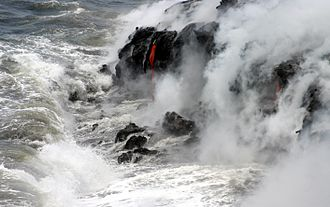 Hawaii - Pāhoehoe, or smooth lava, spills into the Pacific Ocean, forming new rock off the coast of the Island of Hawaii.