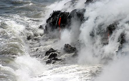 Pahoehoe , or smooth lava, spills into the Pacific Ocean, forming new rock off the coast of the Island of Hawai`i. Pahoehoe lava meets Pacific.jpg
