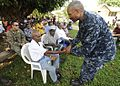Pacific Partnership commander meets oldest man in Hog Harbor 110504-N-YM863-554.jpg