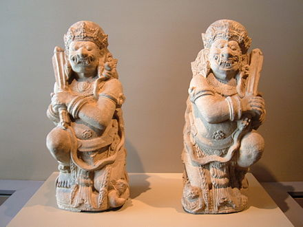 Pair of door guardians from a temple, Eastern Java, 14th century, Museum of Asian Art, San Francisco. Pair of door guardians SF Asian Art Museum.JPG
