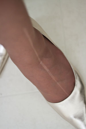 A Ladder or Run on tan coloured pantyhose