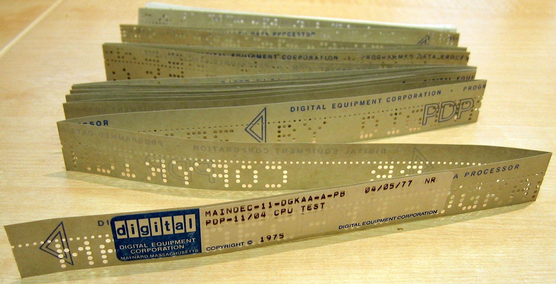 example of fanfold papertape with printed label and punched characters