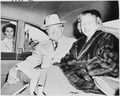 Photograph of President Truman and his daughter Margaret Truman in the back of their limousine, upon their return... - NARA - 200211.tif