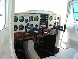 "Yoke (aeronautics) - ""W""/""U"" style yoke in a Cessna 152 light aircraft, mounted on a horizontal tube protruding from the instrumental panel."