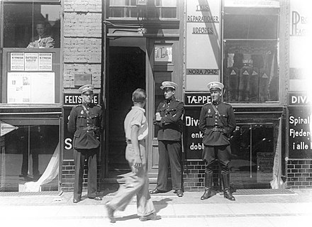 Danish Police officers stand in front of the Communist Party headquarters Police officers in front of Griffenfeldtsgade 50 in Copenhagen - the communist partys head quarter (9443121286).jpg