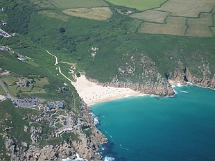 "Aerial view of Porthcurno Beach showing the Minack Theatre in the cliff face, Green Bay and the generally faint cliff-top course of the <a href=""http://search.lycos.com/web/?_z=0&q=%22South%20West%20Coast%20Path%22"">South West Coast Path</a>."