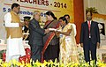 Pranab Mukherjee presenting the National Award for Teachers-2014 to Smt. Nirada Gogoi, Assam, on the occasion of the 'Teachers Day', in New Delhi. The Union Minister for Human Resource Development, Smt. Smriti Irani.jpg