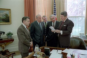 President Ronald Reagan meets with aides on Iran-Contra.jpg