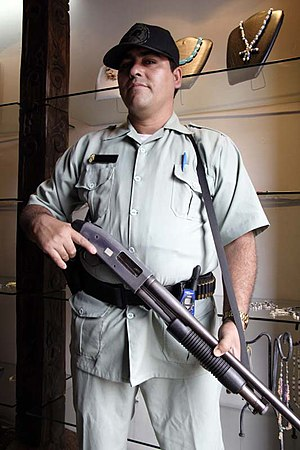 English: Antigua Guatemala: armed guard stands...