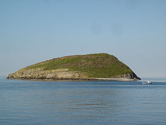 History of Gwynedd during the High Middle Ages - Norse raiders appeared off Ynys Seiriol (Puffin island),  seen here from Penmon Point.