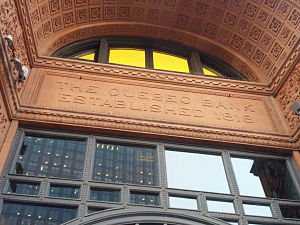 "New York Life Insurance Building (Montreal) - Name carved on the entrance. Note the reverse ""Q"" in ""Quebec""."