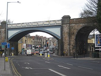 Gloucester Road, Bristol - Railway arches carrying the Severn Beach Line; the start of Gloucester Road is in the distance.
