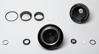 Photographic lens design - Elements of a cheap 28mm lens.