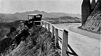 A potential long fall stopped by an early guardrail, ca. 1920.  Guardrails, median barriers, or other physical objects can help reduce the consequences of an accident or minimize damage.