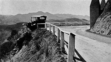 A potential long fall stopped by an early guardrail, ca. 1920. Guardrails, median barriers, or other physical objects can help reduce the consequences of a collision or minimize damage. Ridge Route ca 1920 3.jpg