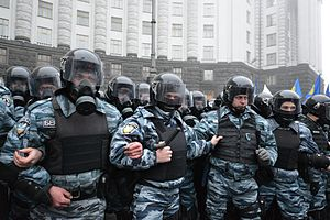 "Berkut (special police force) - Defensive line of ""Berkut"" unitmen in riot gear by the building of the Cabinet of Ministers during 2013 Euromaidan protests."