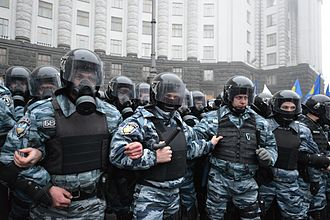 """Berkut (special police force) - Defensive line of """"Berkut"""" unitmen in riot gear by the building of the Cabinet of Ministers during 2013 Euromaidan protests."""
