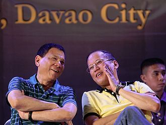Rodrigo Duterte - Duterte (left) with President Benigno Aquino III during a meeting with local government unit leaders in Davao City in 2013