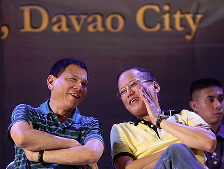 Then-Mayor Duterte (left) with then-President Benigno Aquino III during a meeting with local government unit leaders in Davao City in 2013 Rodrigo Duterte Benigno Aquino III 03.jpg
