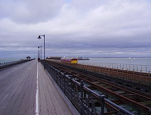 "Ryde Pier - The ""three piers"": the pedestrian and vehicle pier (left), the remains of the old tramway (centre) and the extant railway line (right)"