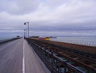 """Ryde Pier - The """"three piers"""": the pedestrian and vehicle pier (left), the remains of the old tramway (centre) and the extant railway line (right)"""