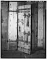 SECOND-FLOOR CELL DOOR, SHOWING HARDWARE - Old Jail, State Route 6A and Old Jail Lane, Barnstable, Barnstable County, MA HABS MASS,1-BAR,3-8.tif