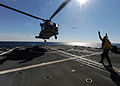 SH-60B Seahawk helicopter lands on carrier deck.jpg