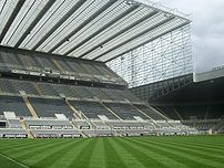 View of the Sir John Hall Stand from the technical area at St James' Park