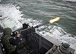 SS Monsoon fires a .50 caliber machine..jpg