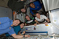 STS-133 crew members in the newly-installed PMM.jpg