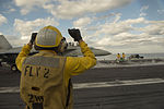 Sailors abroad the USS Dwight D. Eisenhower perform flight operations as Secretary of Defense Ash Carter and India's Minister of Defense Manohar Parrikar tour the aircraft carrier.jpg