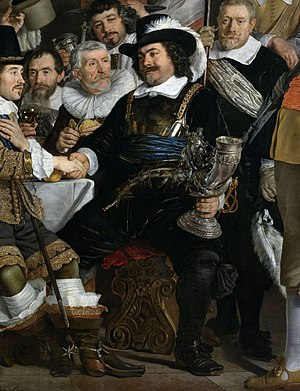 Banquet of the Amsterdam Civic Guard in Celebration of the Peace of Münster - Cornelis Witsen, heading the table and holding a guild cup, shakes Johan van Waveren's hand for peace