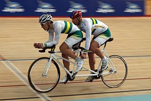 Para-cycling - A tandem bicycle with the visually impaired cyclist in the rear seat, in front is the sighted pilot