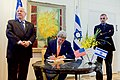 Secretary Kerry Signs a Guest Book at the President's Office in Jerusalem (22882306357).jpg