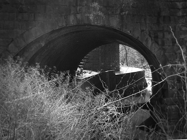 Seldom Seen Arch vignetted in black and white