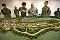 Singaporean army Lt. Col. Jimmy Toh, second from left, briefs Chief of Staff of the U.S. Army Gen. George W. Casey Jr., second from right, about the Murai Urban Warfare Training Facility in Singapore Aug. 26 090826-A-VO565-005.jpg