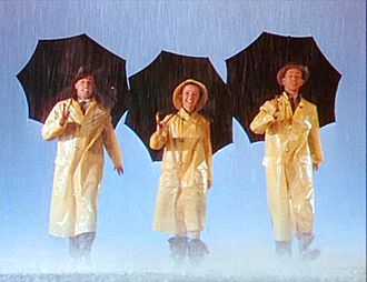 Debbie Reynolds - From left to right, Gene Kelly, Reynolds, and Donald O'Connor during the Singin' in the Rain trailer (1952)