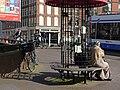 Sitting Moroccan women in the street Kinkerstraat, Amsterdam-West -Marrokaanse vrouwen zitten in de Kinkerstraat, Amsterdam.jpg