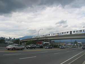 Expo Line (TransLink) - An Expo Line train passing over Clark Drive