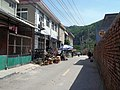 Small convenience store. Those are boxes of alcoholic beverages in front. - panoramio.jpg