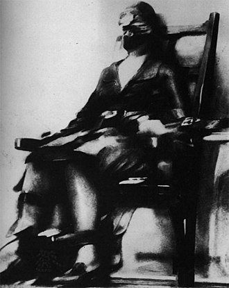 Ruth Snyder - Ruth Snyder's mid-execution photo taken by Tom Howard and published the next day in the New York Daily News.