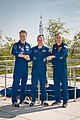 Soyuz MS-05 crew at the Soyuz rocket monument behind the Cosmonaut Hotel.jpg