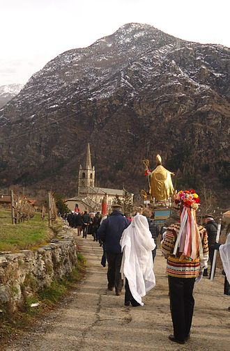 Venaus - Procession of the statue of the patron St. Blaise accompanied by a traditional spadonaro