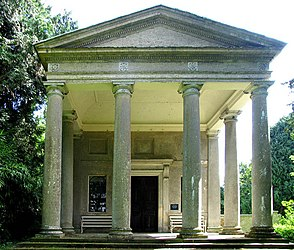 A classical portico with four columns and the entrance to the church beyond