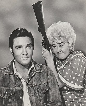 Elvis (1968 TV program) - Presley (left) and Joan Blondell in October 1967, featured on a publicity portrait for Stay Away, Joe. After years of working for the film industry, Presley became unhappy with the quality of his roles.