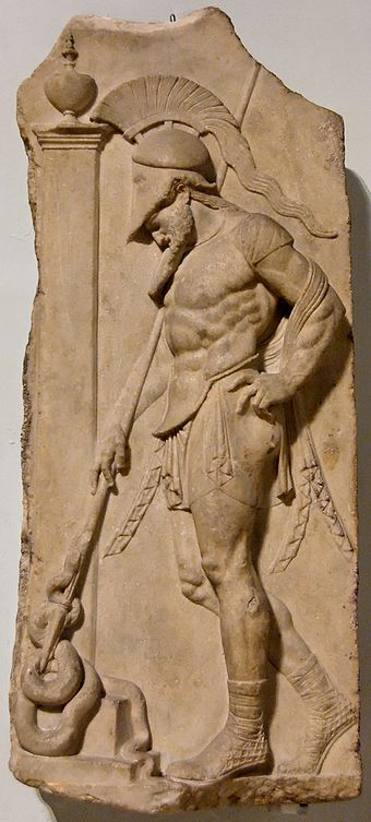 Warrior with cuirass and helmet leaning on his spear in front of a funerary stele; the snake symbolizes the soul of the dead. Marble, Roman artwork from the 1st century BC imitating the Greek classical style of the 5th century BC. From Rhodes. Stele warrior BM GR1905.10-23.1.jpg