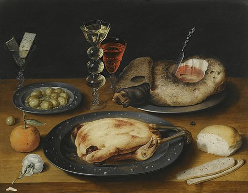 Still Life of a Roast Chicken, a Ham and Olives on Pewter Plates with a Bread Roll, an Orange, Wineglasses and a Rose on a Wooden Table